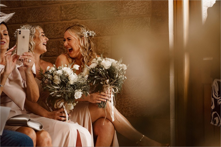 Bridesmaid laughing during the wedding ceremony