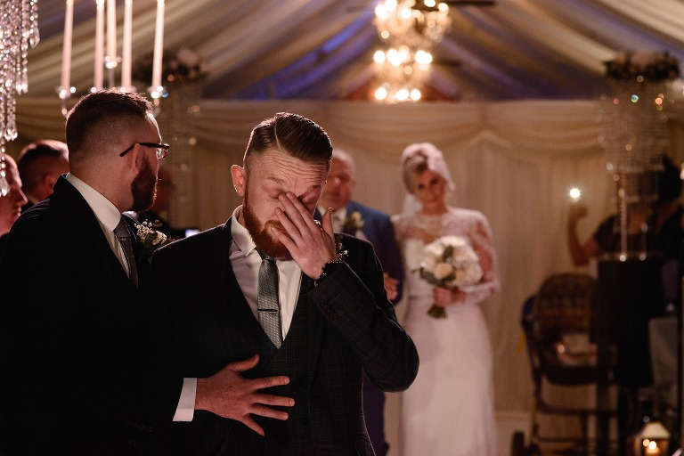 Groom getting emotional as bride walks down the aisle for their wedding ceremony