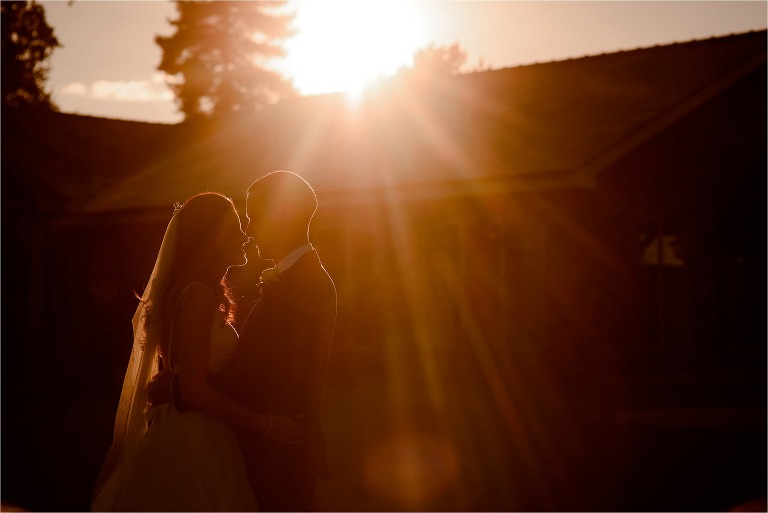 Bride and groom in front of beautiful, golden light