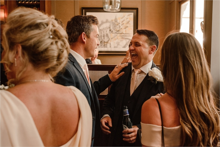 Groom laughing with his Wedding Guests
